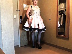 sissy ray in pink sissy dress in hotel bathroom