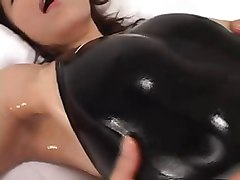 asian in black swimsuit gets lotion and horny