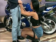 Beautiful brunette slut climbs on a bike