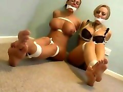 two busty babes tapegagged, tied up, then hogtied