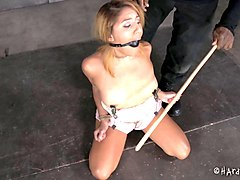 cutie with a gagged mouth and her horny captor with a dirty mind