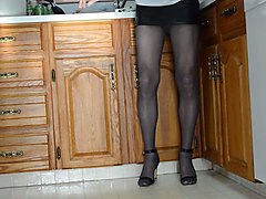 micro mini skirt, pantyhose and high heels