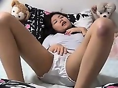 hidden camera films a couple of asian chicks vibrating thei