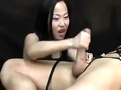 Asian woman torturing him post orgasm handjob