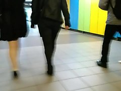 chubby woman with high heels walking